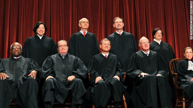 The Justices of the US Supreme Court sit for their official photograph on October 8, 2010 at the Supreme Court in Washington, DC. Front row (L-R): Associate Justice Clarence Thomas, Associate Justice Antonin Scalia, Chief Justice John G. Roberts, Associate Justice Anthony M. Kennedy and Associate Justice Ruth Bader Ginsburg. Back Row (L-R): Associate Justice Sonia Sotomayor, Associate Justice Stephen Breyer, Associate Justice Samuel Alito Jr. and Associate Justice Elena Kagan. AFP PHOTO / TIM SLOAN (Photo credit should read TIM SLOAN/AFP/Getty Images)