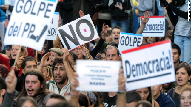 "Protesters take part in a demonstration organized by Spain's ""indignant"" protesters on September 26 in Madrid."