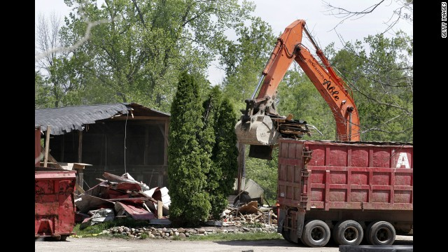 Demolition workers tore down a horse barn at Hidden Dreams Farm in May 2006.