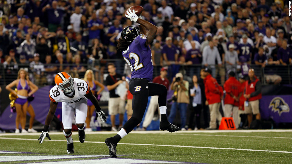 Wide receiver Torrey Smith of the Baltimore Ravens catches a touchdown pass in the second quarter against cornerback Tashaun Gipson of the Cleveland Browns Thursday.