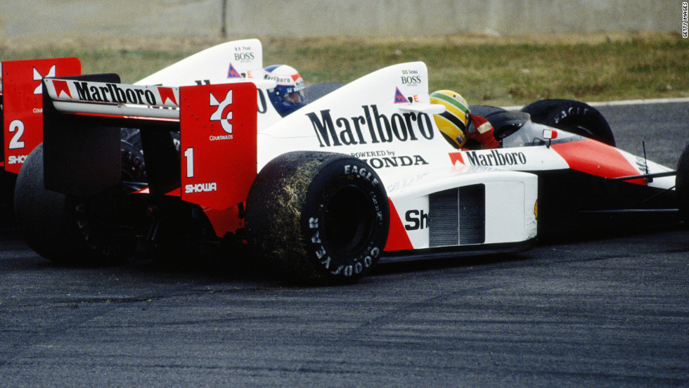 Prost and Senna (No.1) clash at the Japanese Grand Prix at Suzuka in 1989. Prost clinched the title after the Brazilian was controversially disqualified after winning the race.