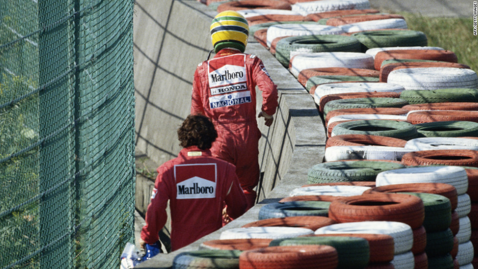 Stand off: Senna and Prost walk away after the early crash at Suzuka in the final race of the 1990 season which left the Brazilian as world champion.