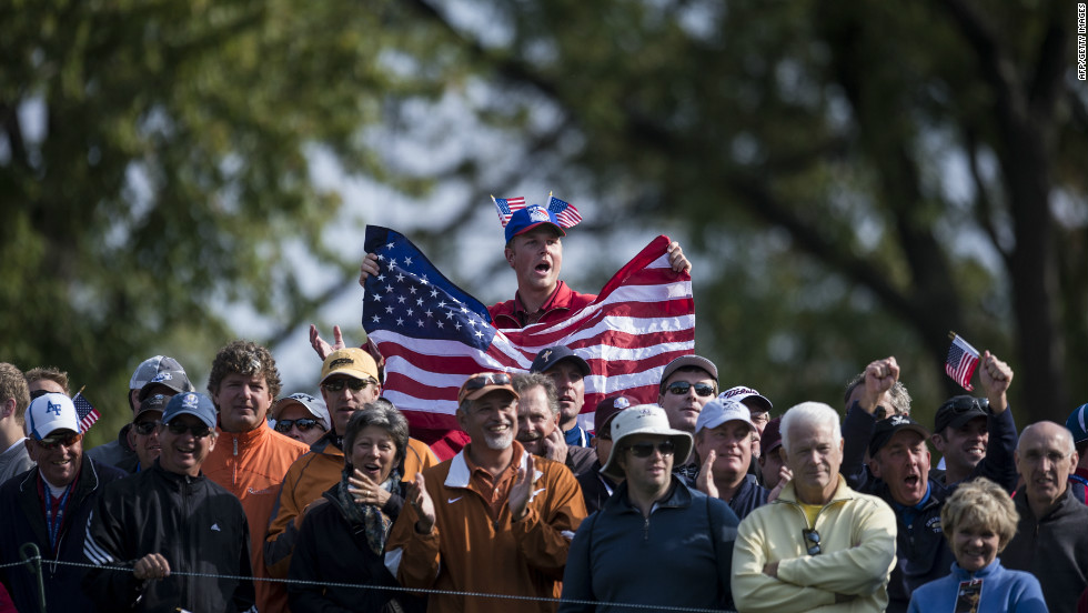 Fans watch during the morning foursome matches Friday at the Medinah Country Club.