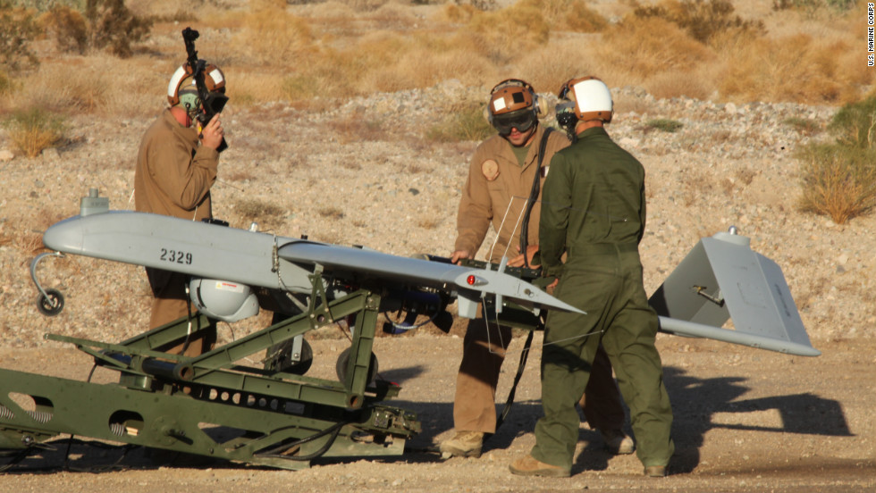 U.S. Marines perform operational checks on a Marine Squadron Two (VMU-2) UAV before a launch at Speed Bag Airfield, near Niland, California, on October 25, 2011.