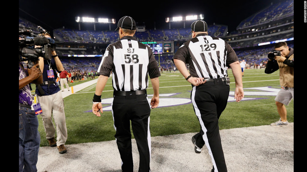 "Game officials take the field before the start of the Baltimore Ravens and Cleveland Browns game on Thursday, September 27 in Baltimore, Maryland. <a href=""http://www.cnn.com/2012/09/20/football/gallery/nfl-week-3/index.html""><strong>Look back at the best of Week Three.</a></strong>"