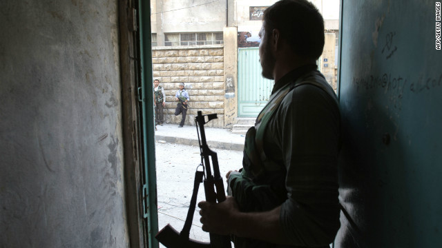 Rebel fighters hold their position 50 meters away from government troops during fighting in Aleppo on Thursday.