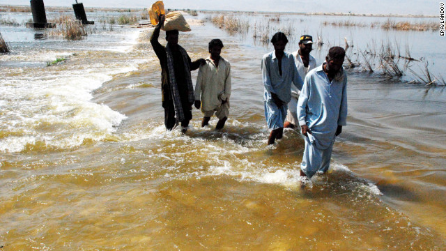 People flee flooded areas in Shahdadkot, Sindh province, Pakistan, on September 28.