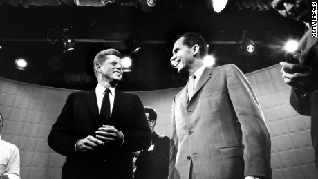 Dem. & Repub. presidential cands. Jack Kennedy (L) & Dick Nixon exchanging smile, standing under glaring lights prior to beginning their 1st TV debate. (Photo by Paul Schutzer//Time Life Pictures/Getty Images)