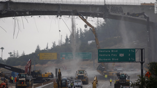 "Workers demolish the south side of Mulholland overpass on the 405 freeway during last year's ""Carmageddon."""