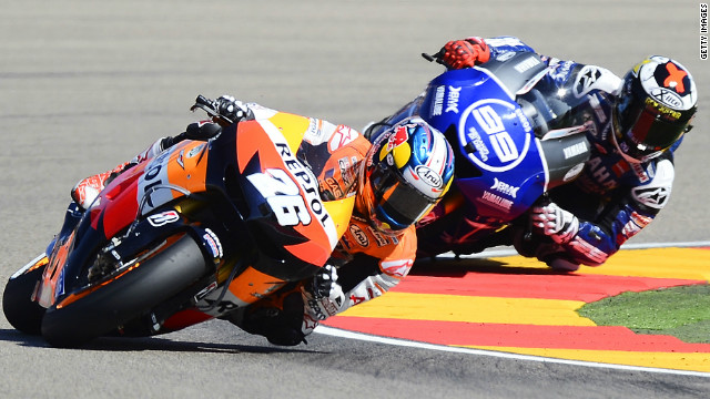 Dani Pedrosa claimed a vital victory at the Aragon GP after beating chief title rival Jorge Lorenzo.