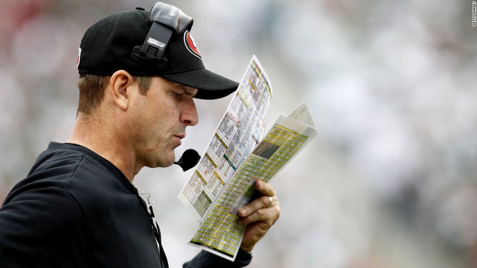Jim Harbaugh, San Fransisco 49ers head coach, looks at notes during Sunday's game against the New York Jets.