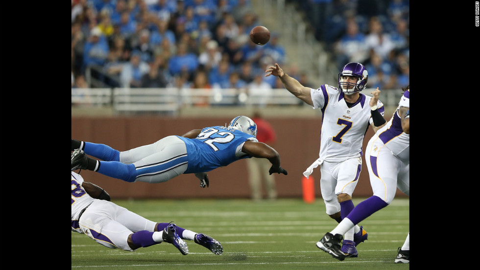 Minnesota Vikings quarterback Christian Ponder passes the football as Cliff Avril of the Detroit Lions attempts a diving tackle on Sunday at Ford Field in Detroit.