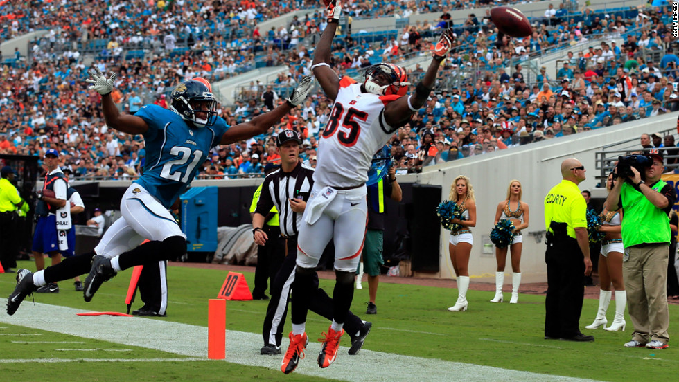 Derek Cox of the Jacksonville Jaguars attempts to break up a pass intended for Armon Binns of the Cincinnati Bengals on Sunday at EverBank Field in Jacksonville, Florida.