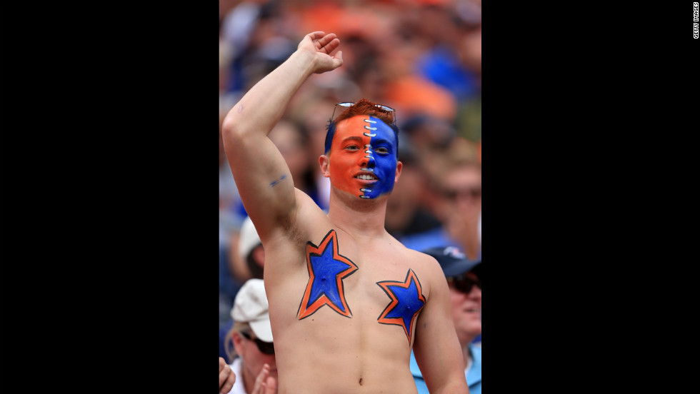 A fan cheers on the Denver Broncos on Sunday.