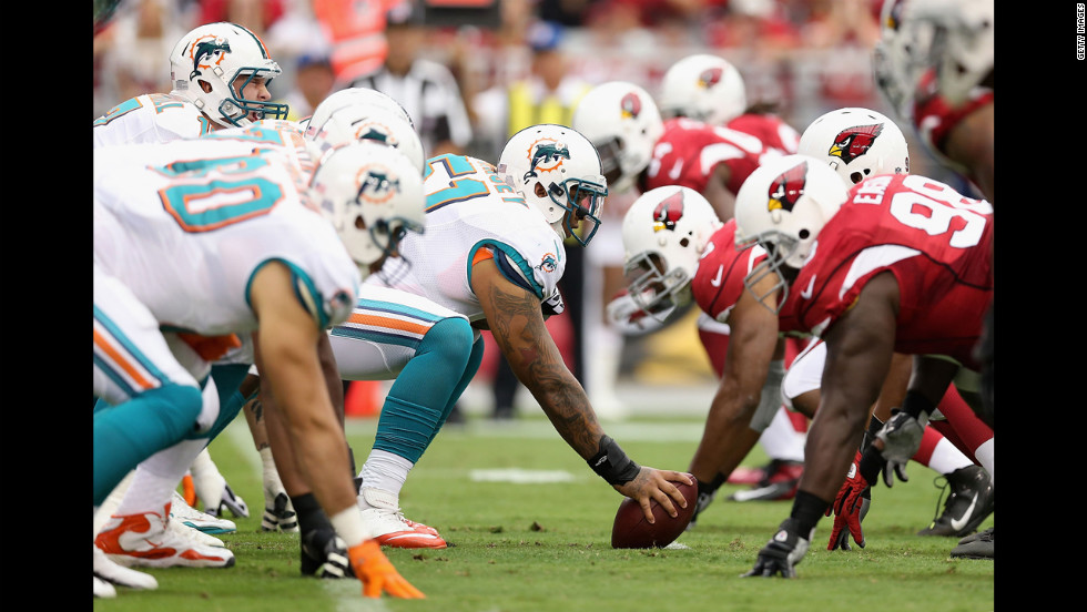 Mike Pouncey of the Miami Dolphins prepares to snap the football to quarterback Ryan Tannehill during Sunday's game against the Arizona Cardinals.
