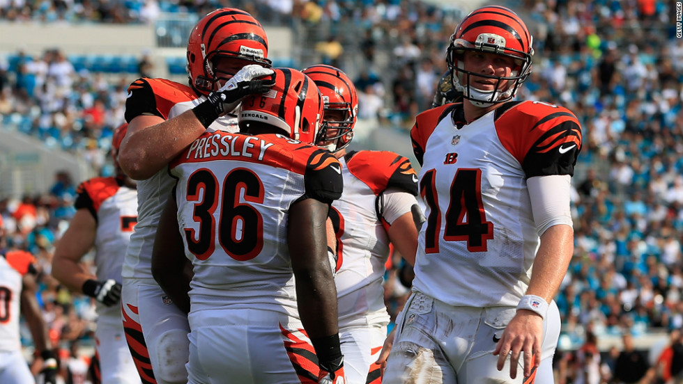 Chris Pressley of the Cincinnati Bengals is congratulated by his teammates after a touchdown Sunday against the Jacksonville Jaguars.