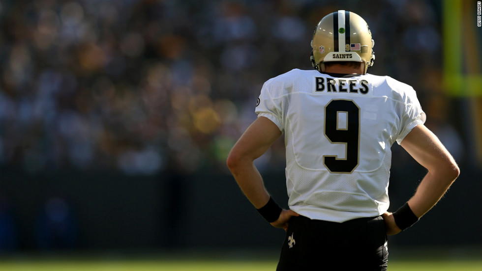 Quarterback Drew Brees of the New Orleans Saints awaits the start of play against the Green Bay Packers on Sunday.