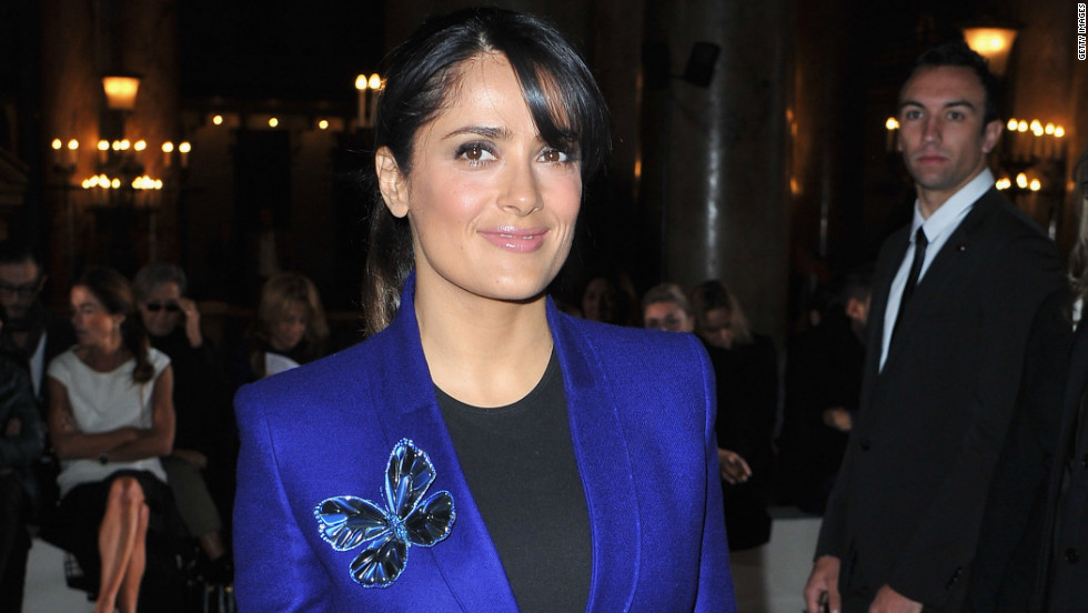 Salma Hayek arrives at a show during Paris Fashion Week.