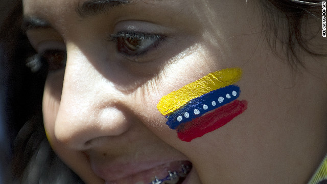 A supporter of Venezuelan opposition presidential candidate for October 7 election Henrique Capriles during a campaign rally at Los Teques in Caracas on September 21, 2012
