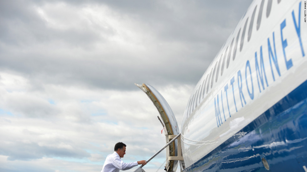 Romney boards his campaign plane in Bedford, Massachusetts, on Monday, October 1. The Republican candidate was heading to Denver for the first presidential debate on Wednesday.