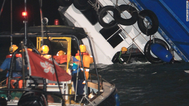 "A rescuer looks through a door of a rapidly sinking ship after a collision between a ferry and another boat killed eight people and injured 45 others off Hong Kong late on October 1, 2012. ""Up to midnight 53 persons were received by four hospitals and eight were certified dead, "" a Hospital Authority spokesman told AFP. The government said around 120 people were on board the vessels, of whom 101 had been rescued. HONG KONG OUT - TAIWAN OUT RESTRICTED TO EDITORIAL USE - MANDATORY CREDIT ""AFP PHOTO/Apple Daily"" - NO MARKETING NO ADVERTISING CAMPAIGNS - DISTRIBUTED AS A SERVICE TO CLIENTS - NO ARCHIVES AFP PHOTO/Apple DailyAPPLE DAILY/AFP/GettyImages"