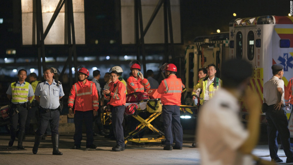 Medical and rescue personnel wait for survivors by the ferry pier.