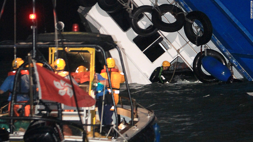 A rescuer looks through a window of the rapidly sinking ship.