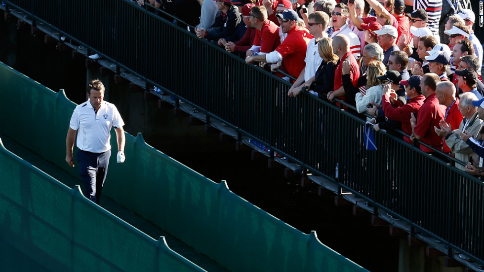 Graeme McDowell of Europe crosses a bridge during the singles matches on Sunday.