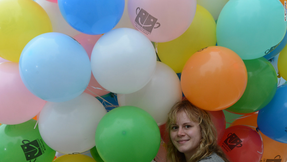 A girl holds balloons during Sunday's concert.
