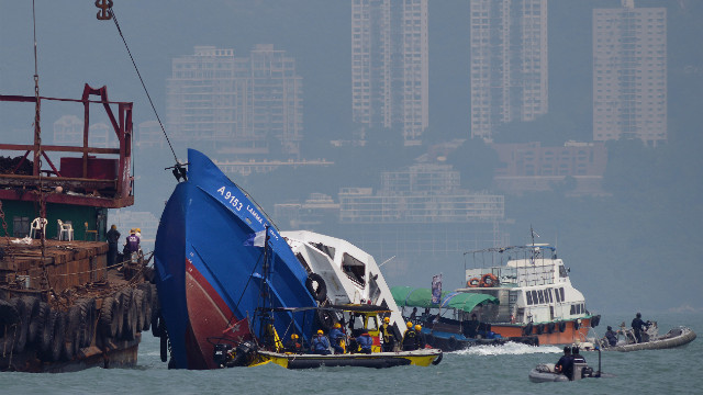 The bow of the Lamma IV boat (L) is seen partially submerged during rescue operations on October 2, 2012 the morning after it collided with a Hong Kong ferry killing over 30 people. The boat, filled with more than 120 people headed to watch a national day fireworks display in Victoria harbour, collided with a passenger ferry and sank off Hong Kong, leaving 36 people dead and sparking a frantic overnight search and rescue effort, officials said on October 2