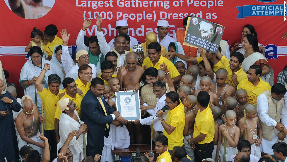 Jain Muni Shri Tarun Sagarji, center, accepts a certificate from an official of Guinness World Records.