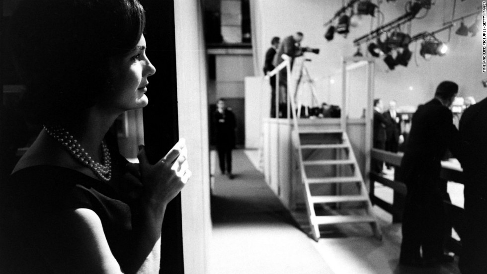 Jacqueline Kennedy watches from the wings as her husband debates Richard Nixon.