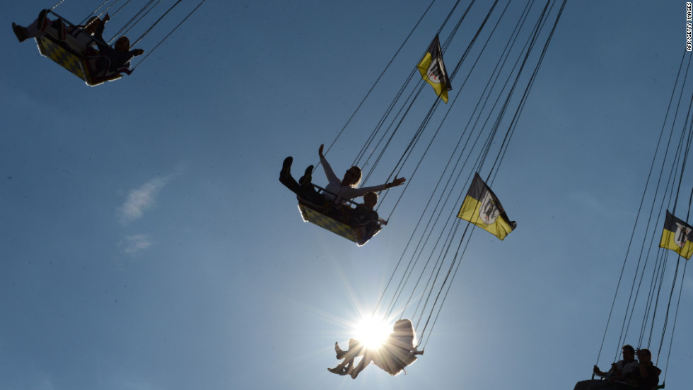 Festivalgoers enjoy a ride at the Theresienwiese fairgrounds in Munich, Germany, at the Oktoberfest beer festival on Tuesday, October 2.