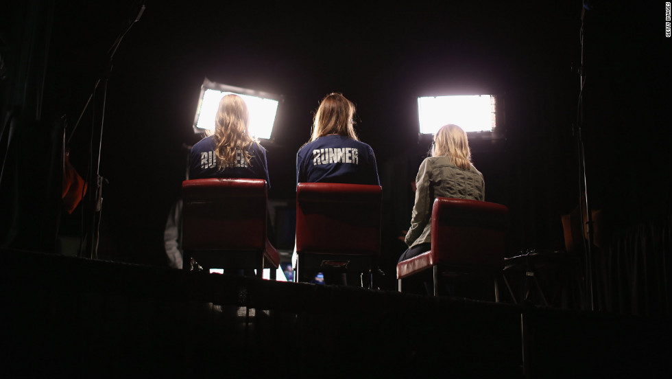 Volunteers sit in for on-air television reporters on Tuesday in preparation for the first presidential debate in the Ritchie Center at the University of Denver.