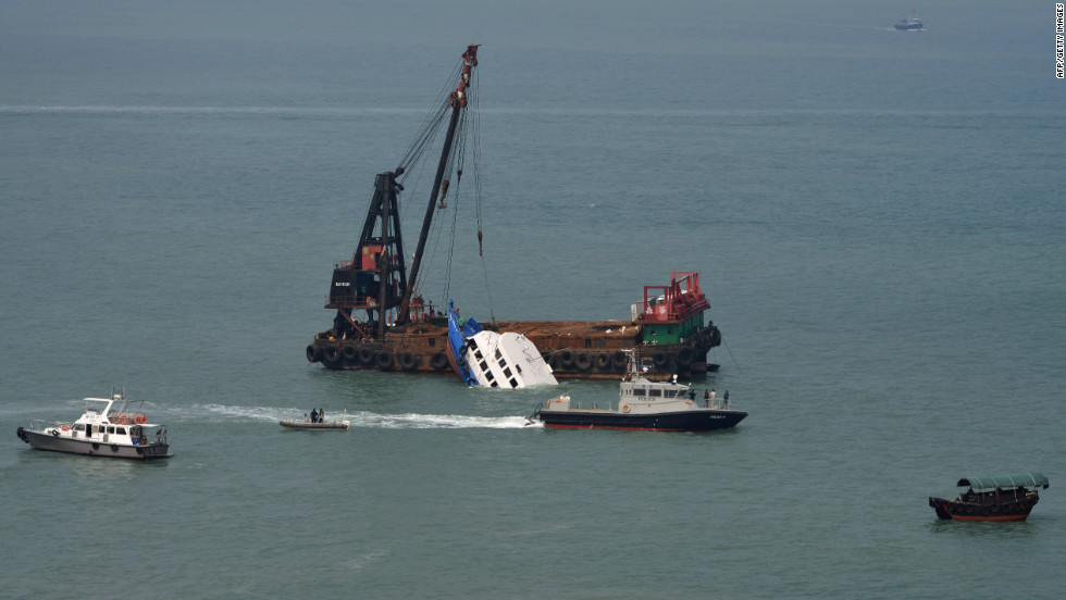 The boat that collided with a Hong Kong passenger ferry is partially submerged during rescue operations Tuesday, October 2.
