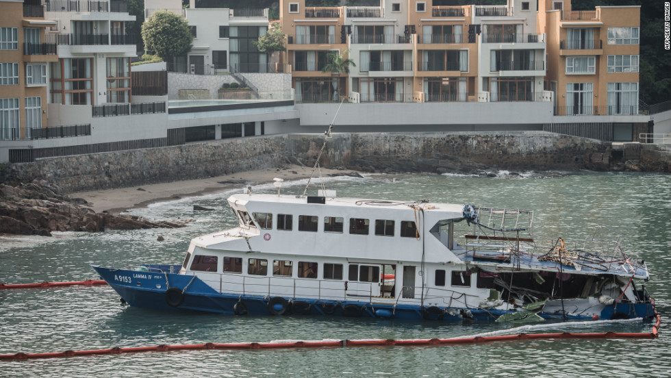 The passenger boat, with the back end of the vessel badly damaged after the collision, sits near the shores of Lamma Island on Wednesday.