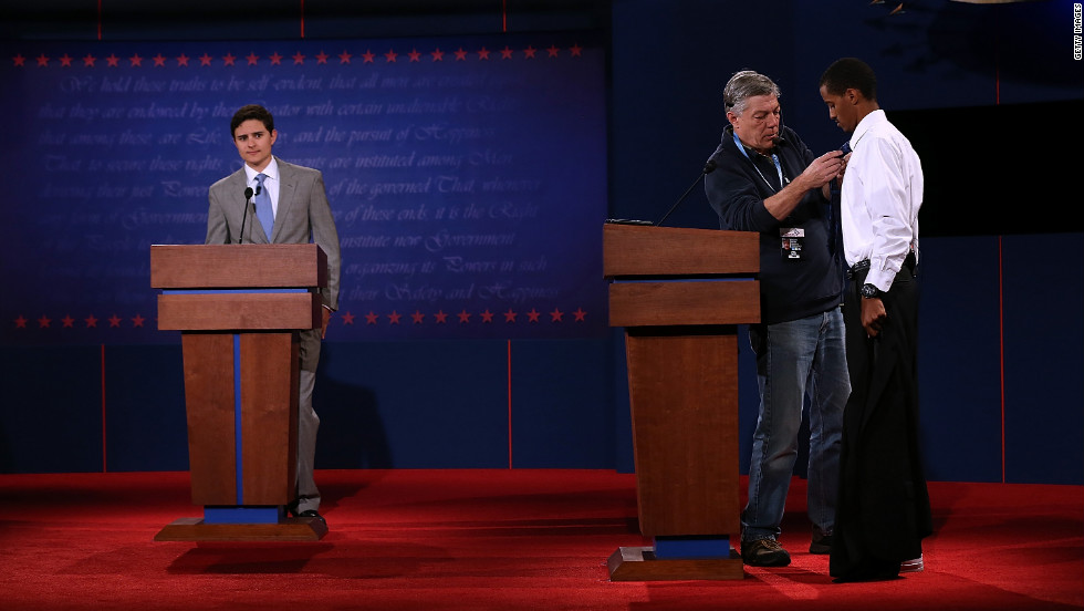 Gonzales, left, and Mohamed stand in for Romney and Obama on Tuesday.