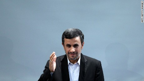 Iranian President Mahmoud Ahmadinejad waves during a press conference in Tehran on October 2, 2012.