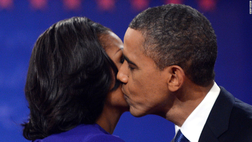 President Obama kisses first lady Michelle Obama after the debate Wednesday. It took place on their 20th wedding anniversary.