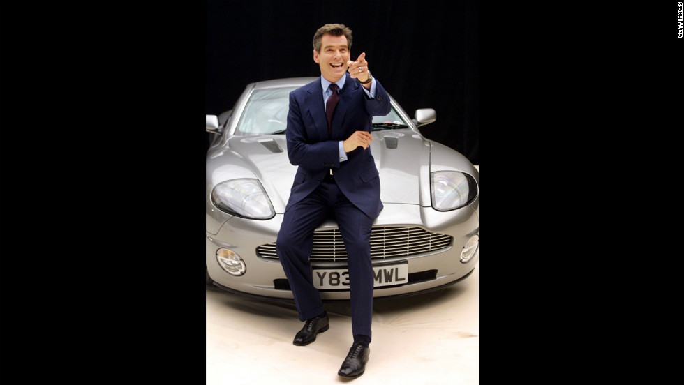 "Pierce Brosnan poses on an Aston Martin before starting filming on ""Die Another Day"" in January 2002."