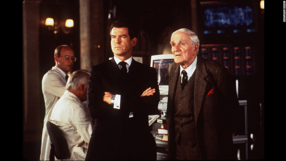 "Pierce Brosnan and Desmond Llewelyn, as Q, on the set of ""The World Is Not Enough."""
