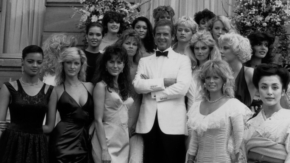 "Roger Moore poses with the  Bond Girls from the film ""View to a Kill"" in 1984."