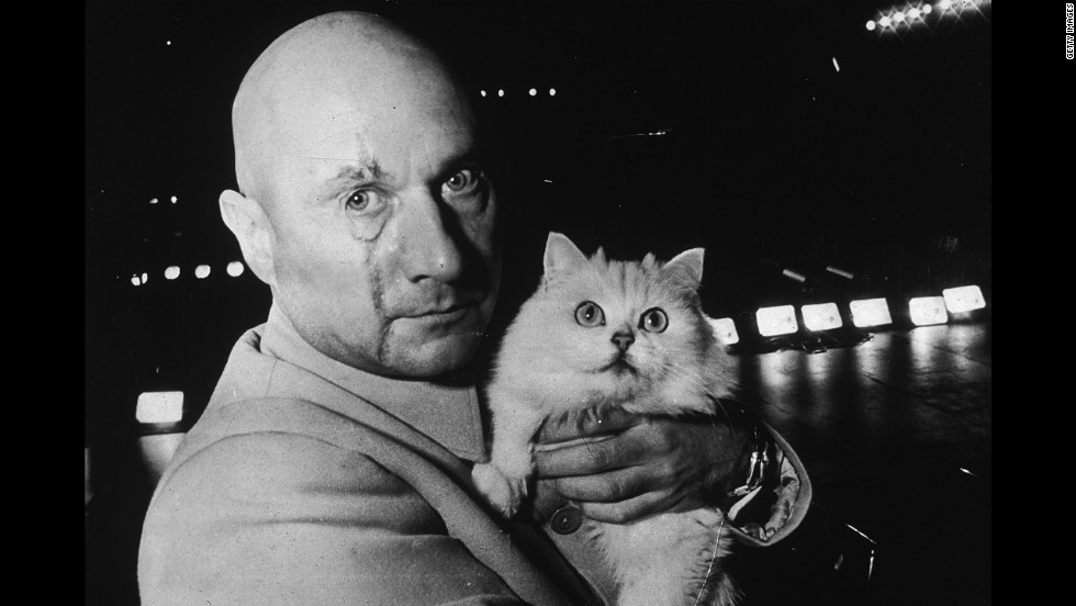 "Donald Pleasence  in character as Ernst Stavro Blofeld, holding a white cat on the set of ""You Only Live Twice,"" in November 1966."