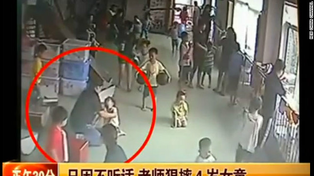 Video grab taken from Chinese news report posted on YouTube purportedly shows girl being manhandled.