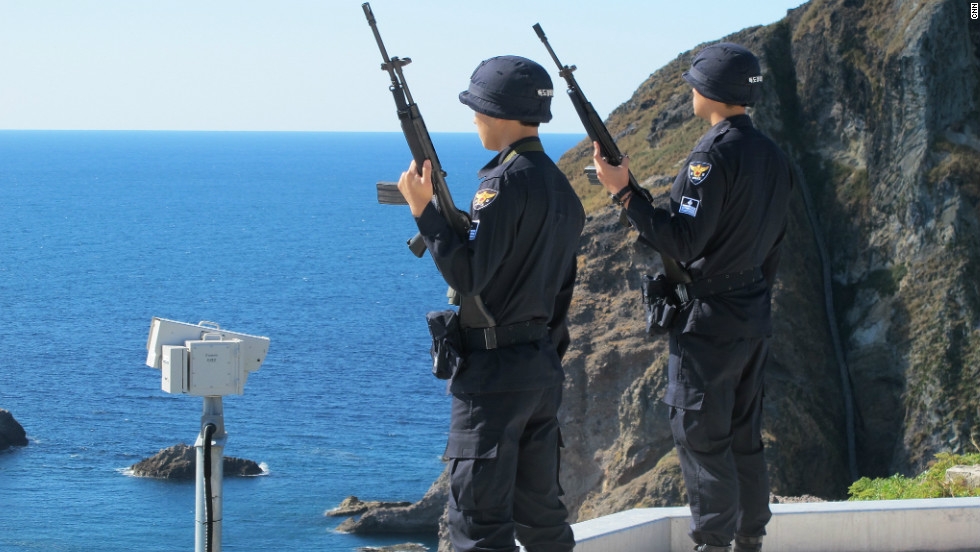 "South Korean police watch over the rocky outcrop located between the Korean peninsula and Japan. The head of the Dokdo guards, Lee Gwang-seup says, ""Japan wants to take our land by force. This has been our land since ancient times and we have to protect it."" Japan calls the islands Takeshima."