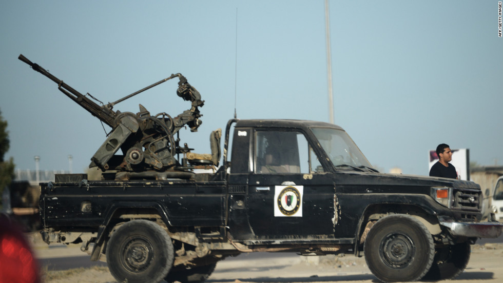 A pick up mounted with anti air craft machine gun is parked on a sidewalk on September 25, 2012 in Misrata, Libya. Tension rose in Misrata after Shaaban's death.