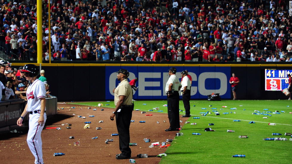 Bottles and cups thrown by unhappy fans litter the field after the controversial call.