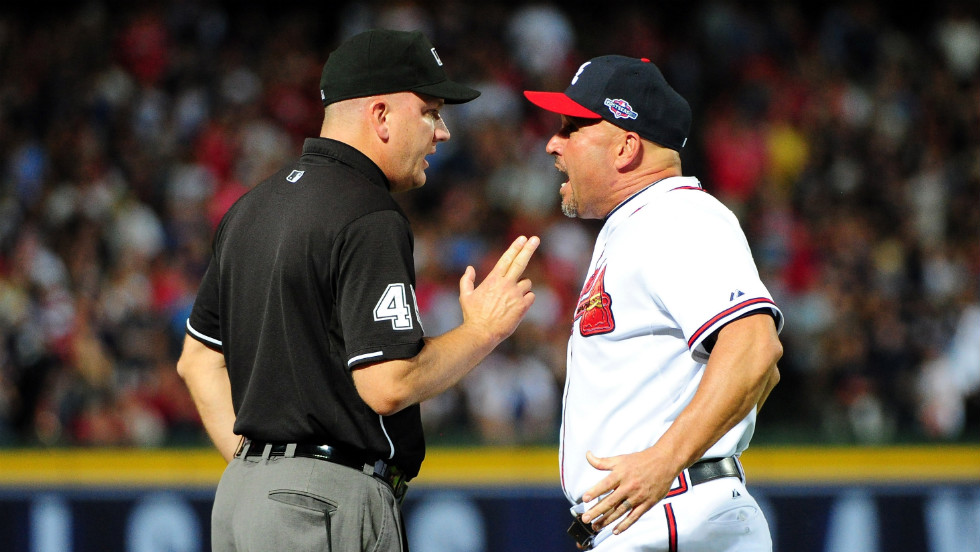 Third base umpire Jeff Nelson and Atlanta Braves manager Fredi Gonzalez argue over the call.