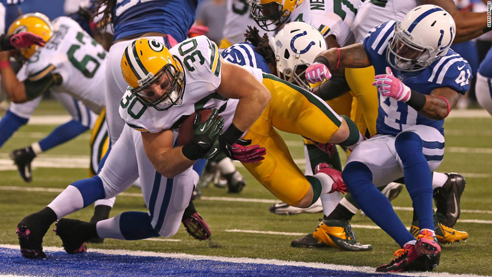 John Kuhn of the Green Bay Packers scores a touchdown Sunday against the Indianapolis Colts.