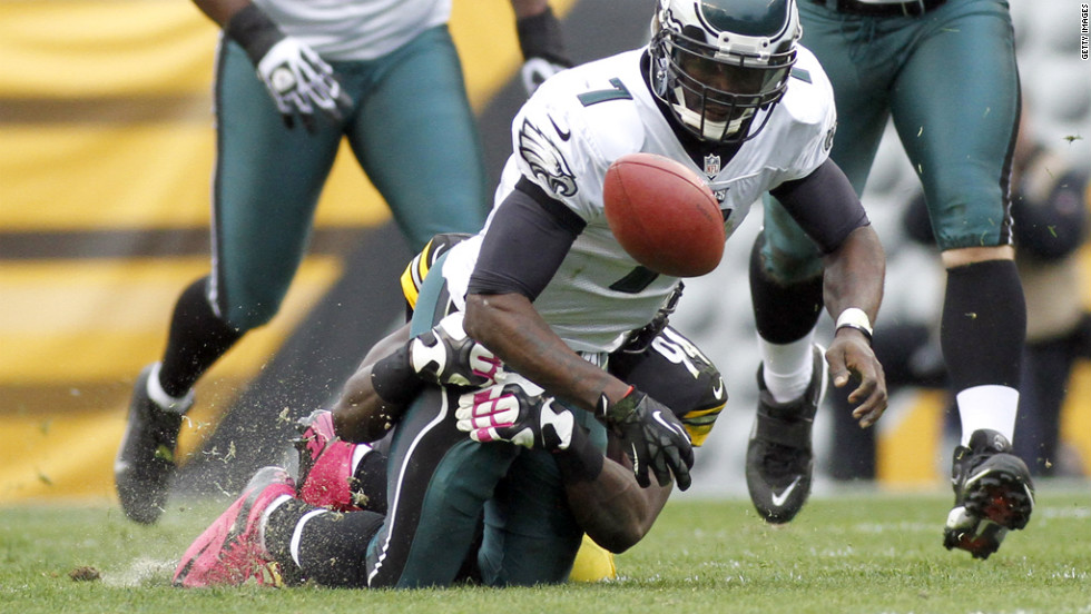 Lawrence Timmons of the Steelers rips the ball from Eagles quarterback Michael Vick on Sunday.